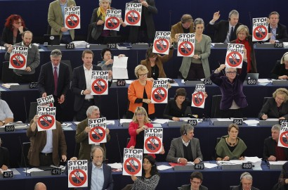 Members of the the Group of the Greens/European Free Alliance of the European Parliament hold leaflets with the slogan stop fracking as they demonstrate against shale gas during a voting session at the European Parliament in Strasbourg