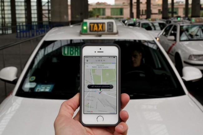 MADRID, SPAIN - OCTOBER 14:  In this photo illustration the new smart phone taxi app 'Uber' shows how to select a pick up location at Atocha Station on October 14, 2014 in Madrid, Spain. 'Uber' application started to operate in Madrid last September despite Taxi drivers claim it is an illegal activity and its drivers currently operate without a license. 'Uber' is an American based company which is quickly expanding to some of the main cities from around the world.  (Photo by Pablo Blazquez Dominguez/Getty Images)