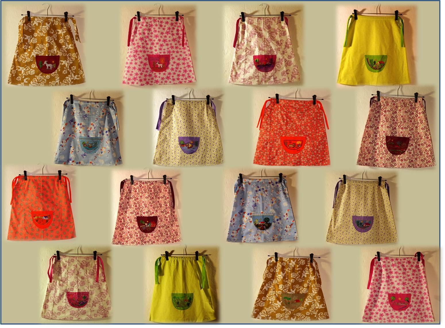 Vestidos confeccionaods e bordados pelas bordadeiras do Atelier Bordados Etc e Tal